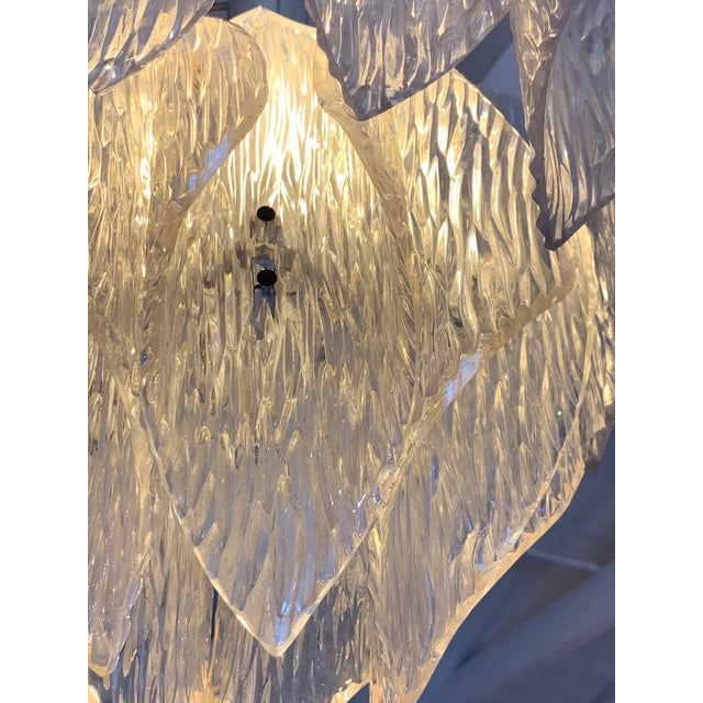 A glamorous and beautifully shaped 1970's Italian lucite chandelier having layers of sculpted lined glass petals. Original...