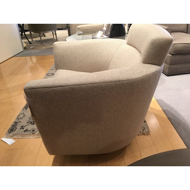 Pair of luxe, modern, contemporary swivel chairs that boast comfort and style and rotate a full 360 degrees. An...
