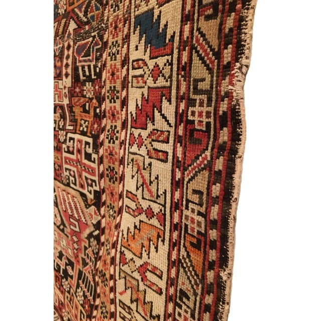 This rare antique Caucasian Shirvan rug was woven in the late 19th Century and features an unusually fine weave of eight...