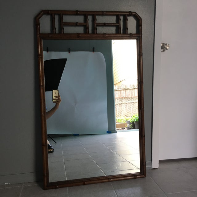 Vintage faux bamboo wall mirror. Perfect size for entry way, above a vanity or bedroom dresser. Mirror was purchased from...