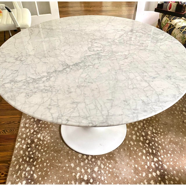 Three year old Carrara marble tulip table for four. Moving and it won't fit in new house. Rarely used as was in breakfast...