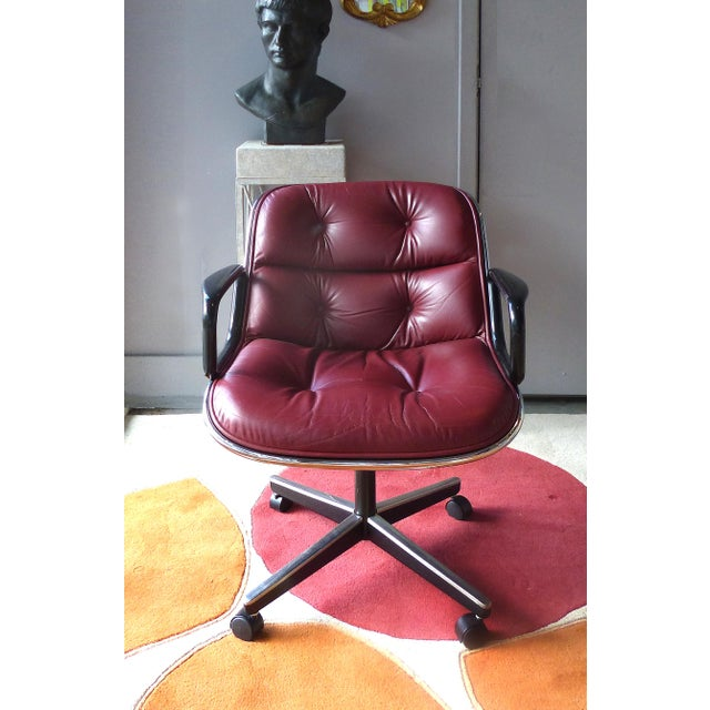 Offered for sale is a pair of iconic Mid-century Modern executive swivel chairs by Charles Pollock for Knoll...