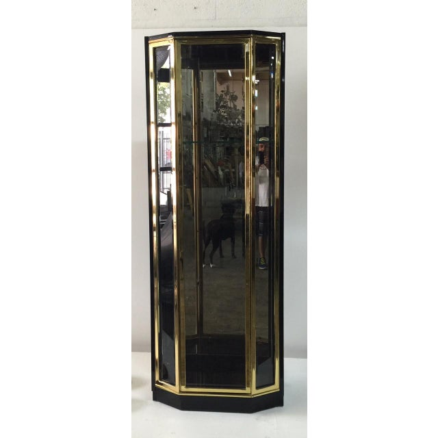 ONE AVAILABLE - Exceptional black lacquer and brass vitrine with adjustable shelves made by Henredon (label). Lights to...