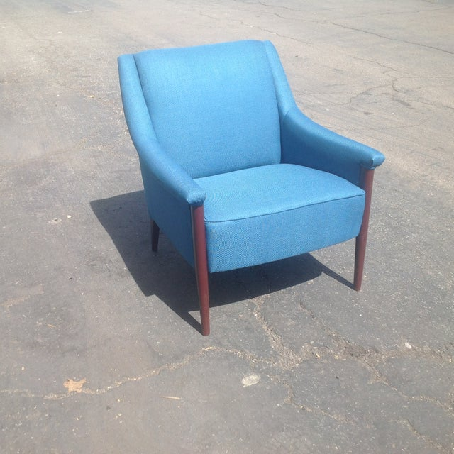 Modern mid century style club chair. The chair is newly upholstered and ready to enjoy. The low profile club chair has a...