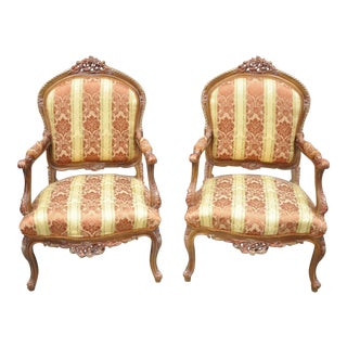 French Louis XV Style Repro Pink and Gold Bergere Lounge Arm Chairs- A Pair For Sale