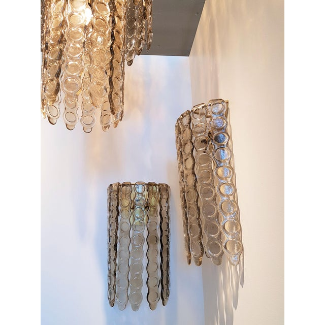 Pair of large smoked textured thick Murano glass wall sconces. Brass frame. 2 lights each. Rewired. Beautiful hand made...