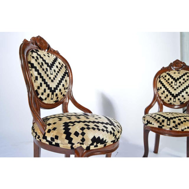 A beautiful antique pair of Victorian parlor chairs having sculpted mahogany frames and stunning original Art Deco velvet...