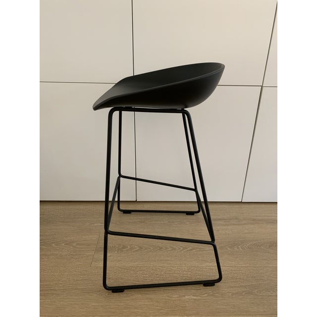 About a Stool 38 Black Counter Height Designed by Hee Welling for Hay Curved backrest on metal legs