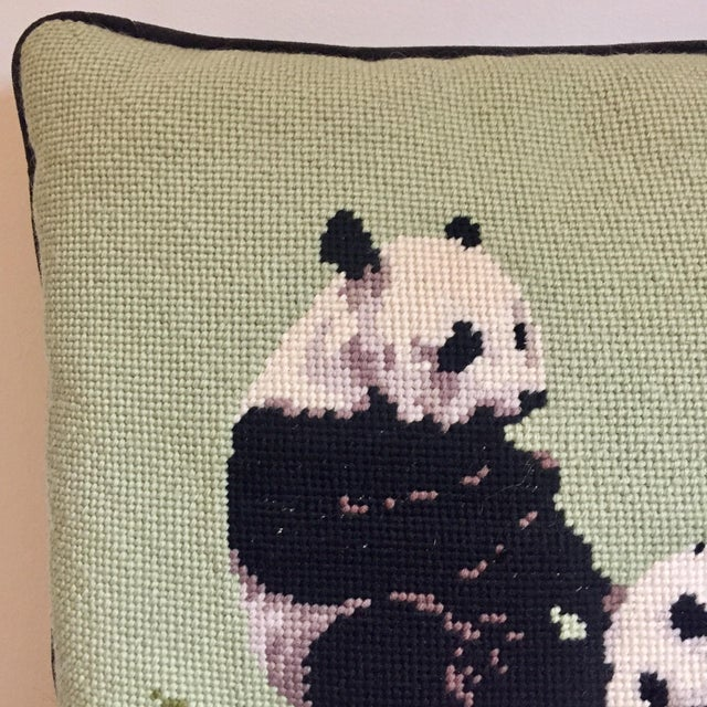 1970s needlepoint pillow with black velvet back and panda bear design. Minor wear consistent with age and detailed in...