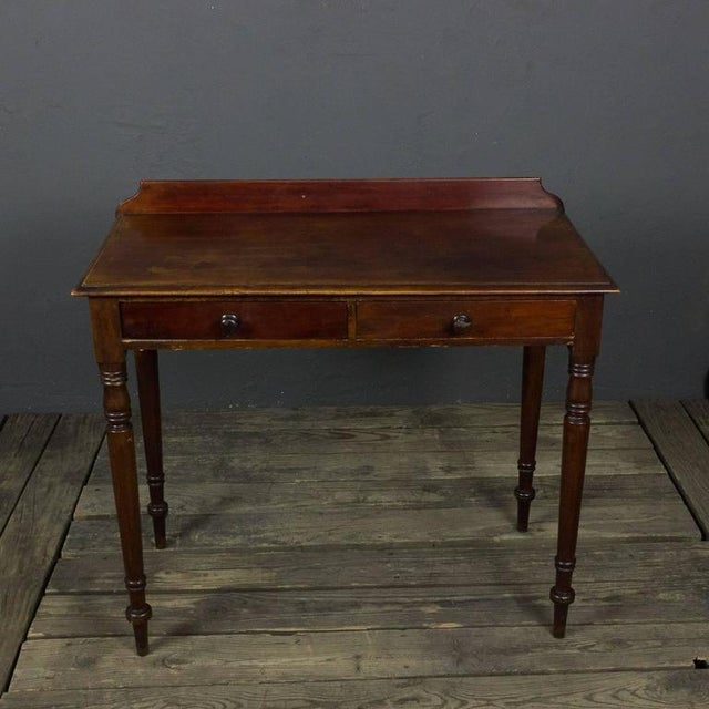 Small French mahogany 19th century desk with two drawers. This desk has turned legs.