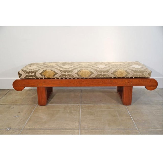 This is a Late 20th Century Bench by Kipp Stewart for Summit Furniture. Teak Bench With New Custom Upholstery. Optional...