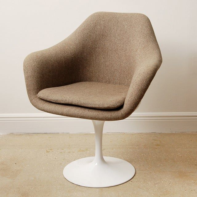 Set of four mid-century Eero Saarinen style swivel tulip chairs in excellent condition with original fabric and foam...