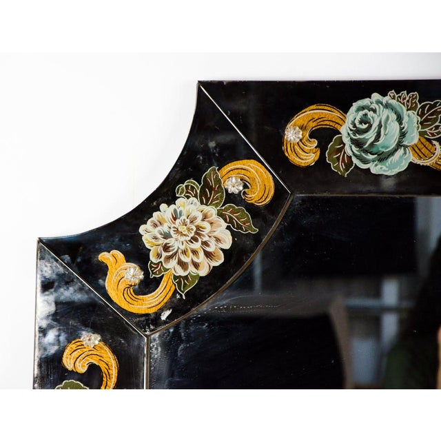 Create the grandest of entrances with this late 19th century Venetian reverse hand painted floral wall mirror in the...