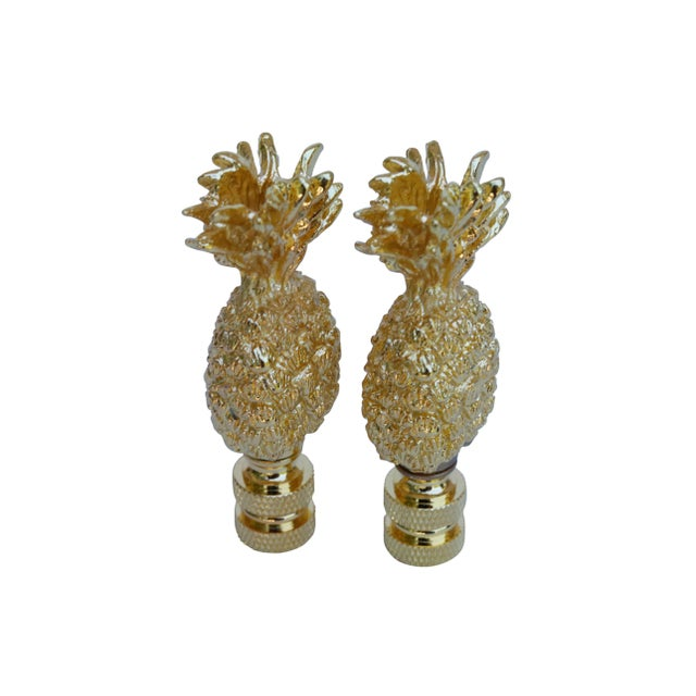 A pair of cast brass pineapple lamp finials. Fits a standard size lamp harp. Measurements per finial. I have more lamp...