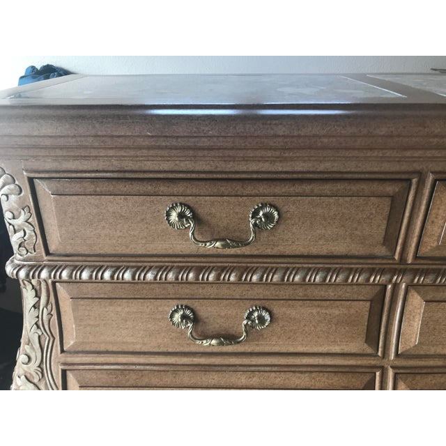 Marge Carson solid wood dresser with hand-applied finish and silver detail. Made in the 1990s.
