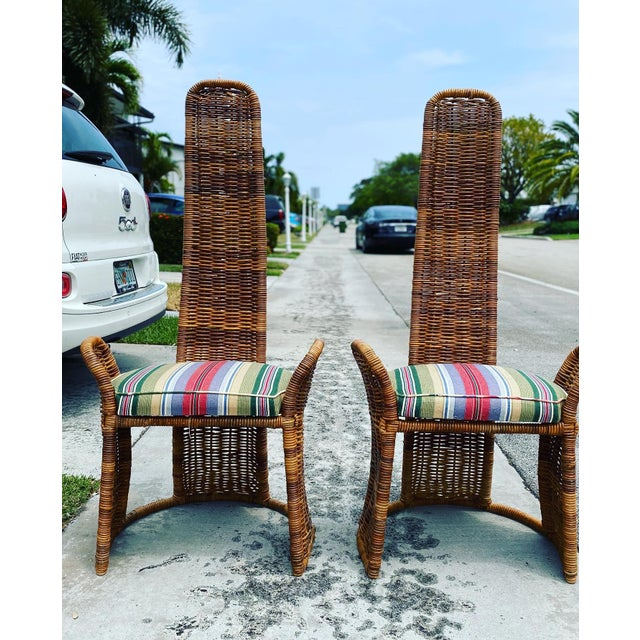 A fantastic pair of arm chairs in wicker over metal frames. These are a combination of asian modern and boho chic. Love...