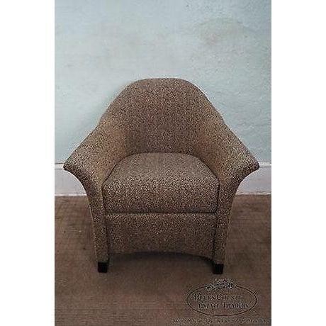 Quality club chair w/ leopard print fabric & wood legs.