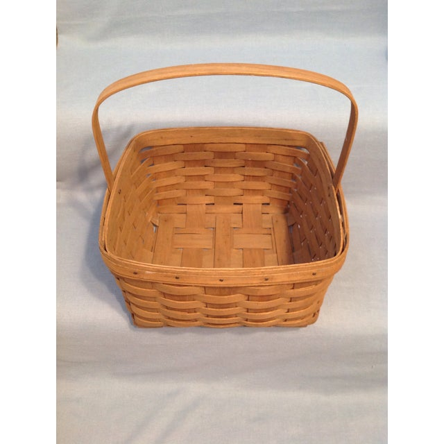 This is a very nice, sturdy vintage basket. Its large size makes it useful as a display piece or as a container for yarn...