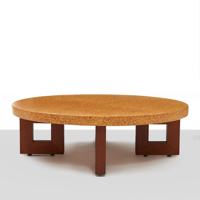 A round, cork top coffee table by Paul Frankl for Johnson Furniture. Features four contrasting, frame-shaped legs. Model...