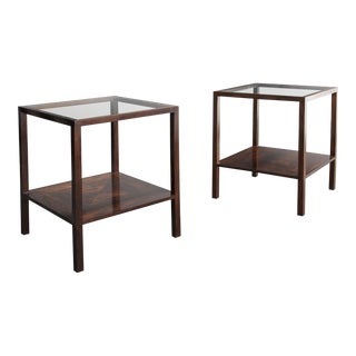 Pair of square side tables in jacaranda with glass tops For Sale