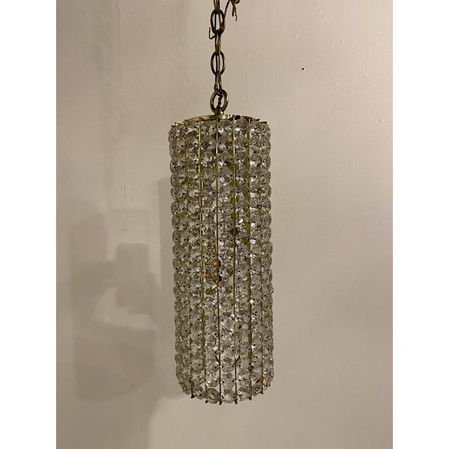 A pair of cilindro shaped crystals light fixtures with 4 interior lights
