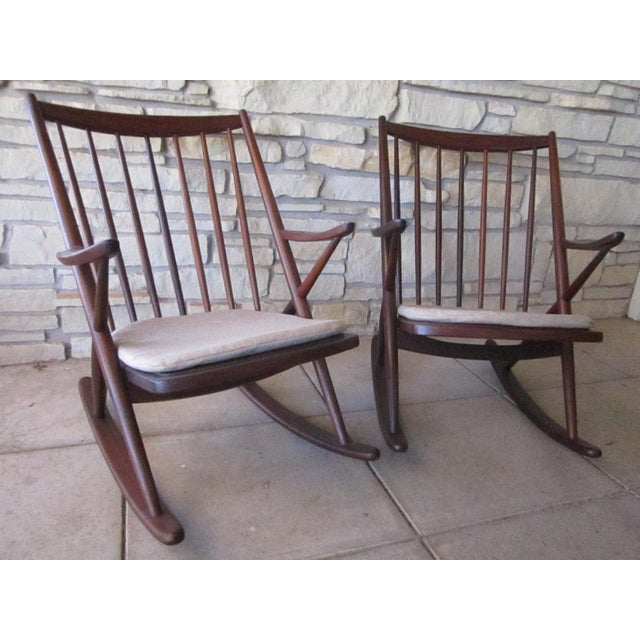 Offering two iconic rocking chairs designed by Dutch designer Frank Reenskaug for the Danish company, Bramin. Uncommon to...