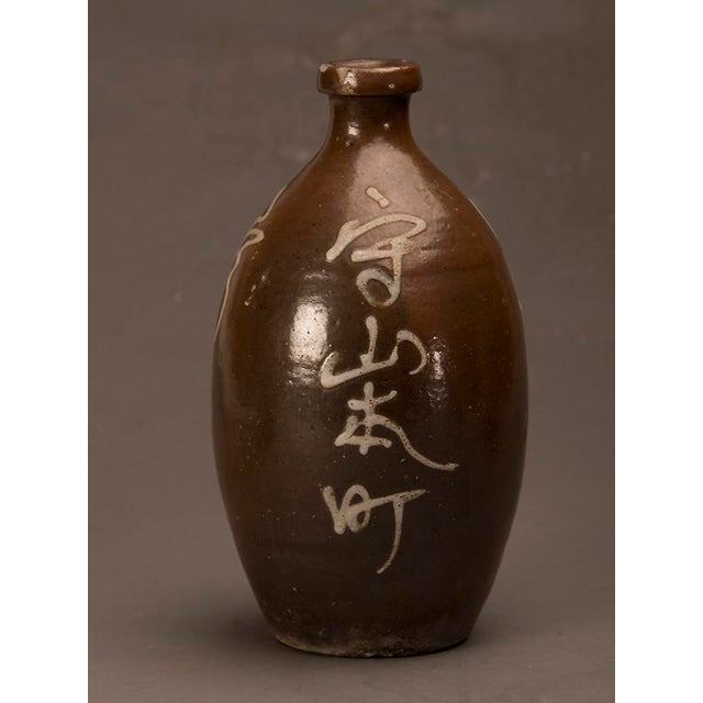 A trio of hand-made earthenware saki jars from Japan c. 1900 For Sale - Image 4 of 10