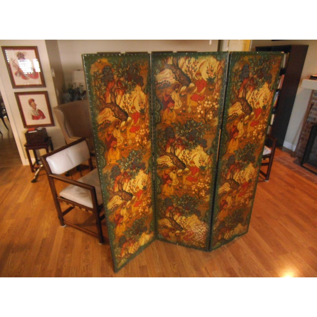 Our European Dressing Screen has polychromed leather panels, mounted on a hinged paneled frame. It's in good condition...
