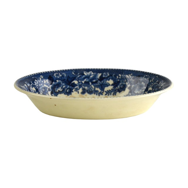 "Offered is a stunning serving bowl adorned with a traditional English rustic scene in indigo blue. Marked: ""Thos. Huches &..."