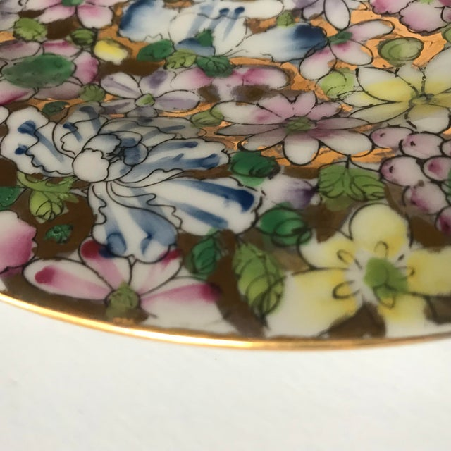 Absolutely beautiful ceramic plate with hand painted flowers on a gold background. This colorful chinoiserie style plate...