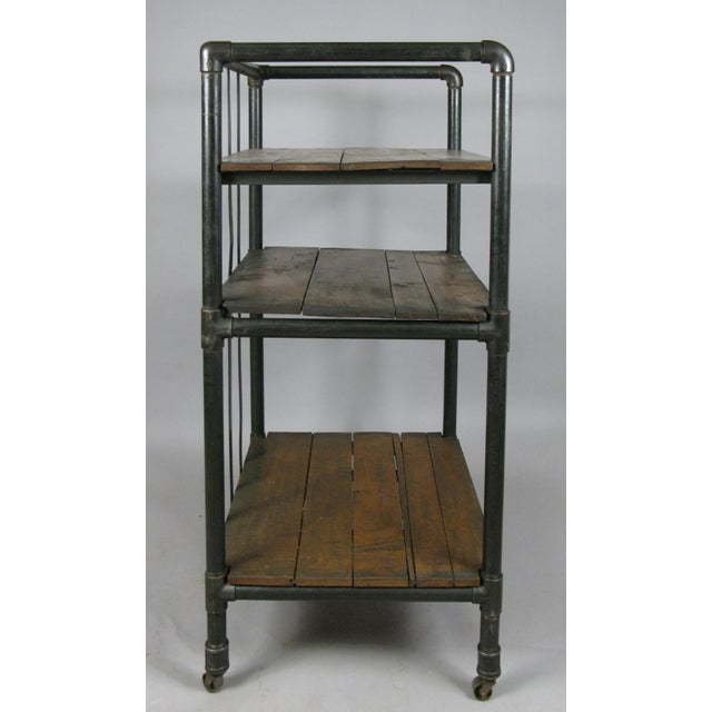 Industrial Antique 1950s Industrial Cast Iron Rolling Cart Bookcase For Sale - Image 3 of 8