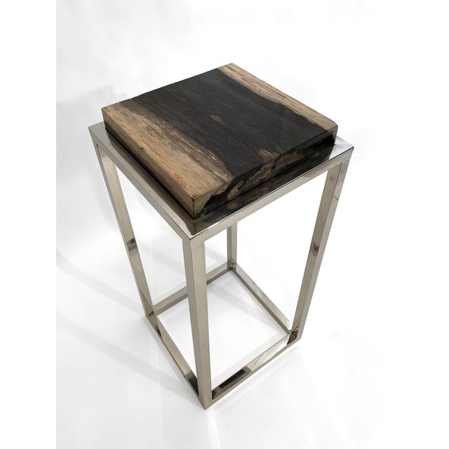 Stylish fossilized stone top side table with modern chrome leg design. It is very sturdy and well constructed.