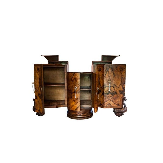 Stunning 1930s Italian Art Deco sideboard with round center cabinet and two large deep adjoining side cabinets. The...