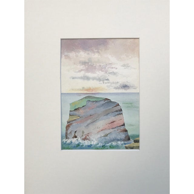 Antique English seascape of a coastal rock formation at sunset. Circa 1900. Presented matted and in a silver wood frame....
