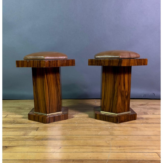 Pair of exceptional low stools with hexagonal shape to top, base and column veneered in a striking rosewood graining....