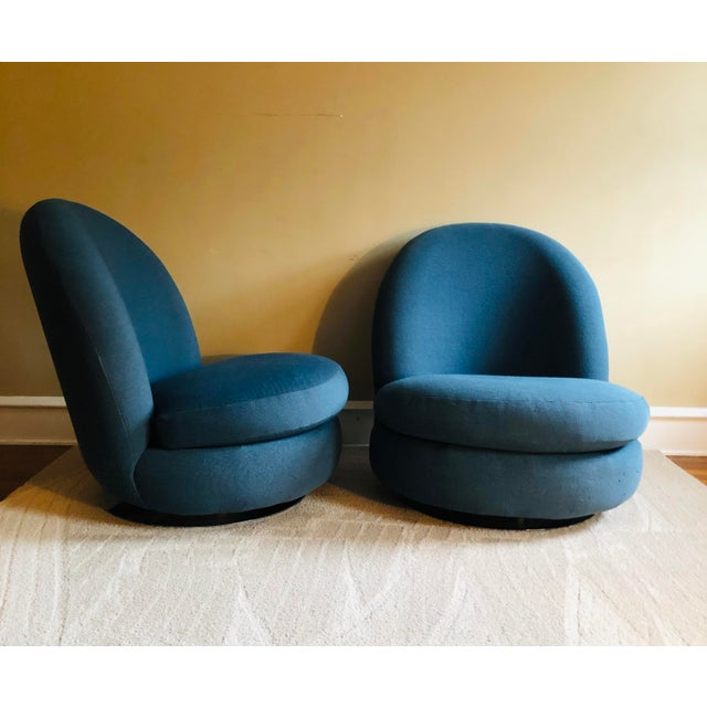 Pair of glamorous 1960s swivel lounge chairs by Milo Baughman for Thayer Coggin. These chairs were reupholstered in a blue...