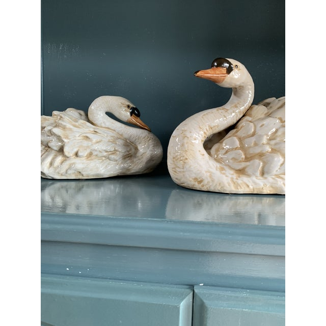 This is a wonderful pair of vintage ceramic swans. They are unmarked but look as though they were made in Italy. There is...
