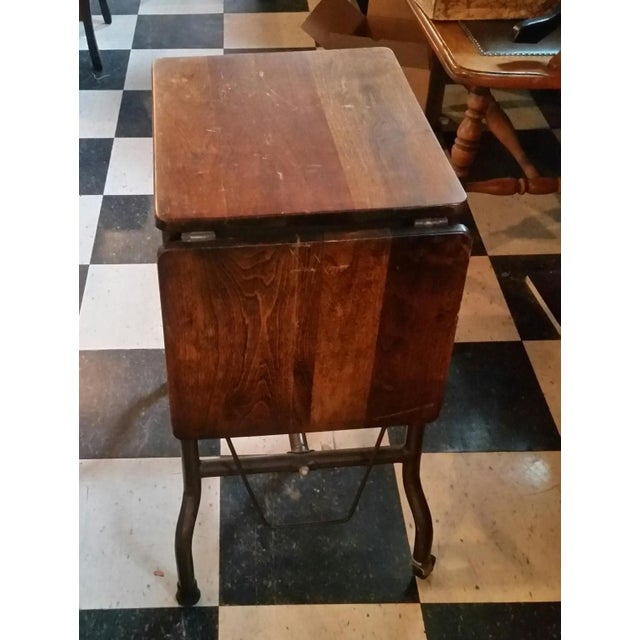 Vintage ideal Sherman-Manson wood/metal typewriter table. Features folding side leaf, pencil drawer and casters on the...