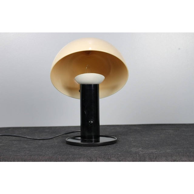 "In style of Achille and Pier Giacomo Castiglioni's ""Snoopy"" table lamp, this mushroom-shaped table lamp features a caffe..."
