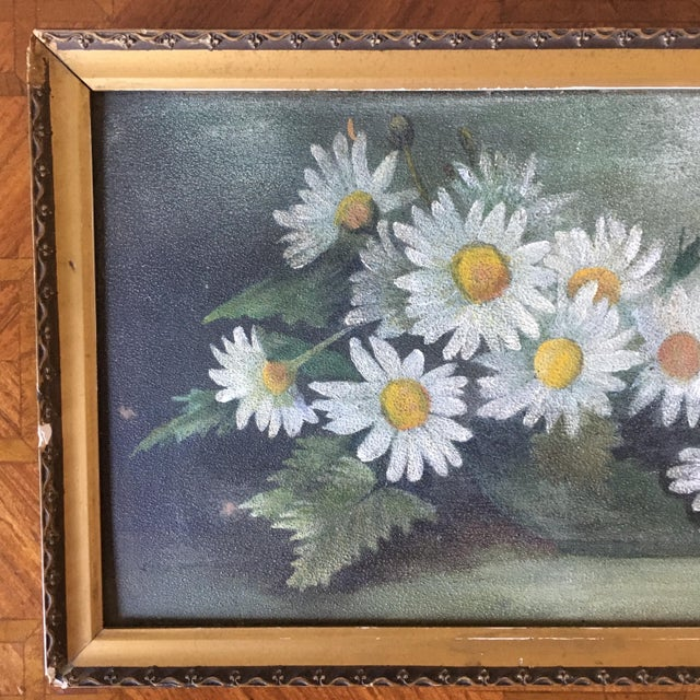 A charming vintage painting on board of daisies in a bowl presented in a gold frame.