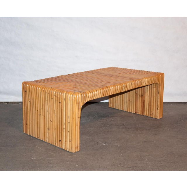 A stunning and superbly crafted rattan coffee table in the waterfall style with steambent triangular details. Excellent...