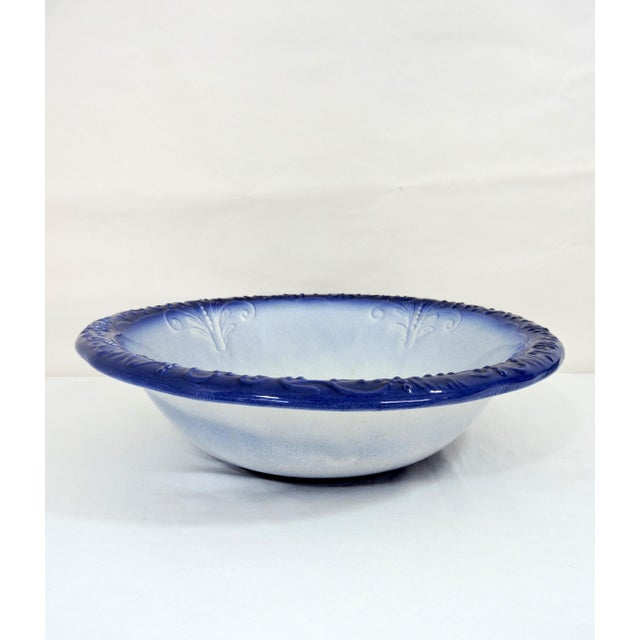Attractive English antique blue and white Ironstone bowl marked 1890. Graduated colouring throughout ending in the...