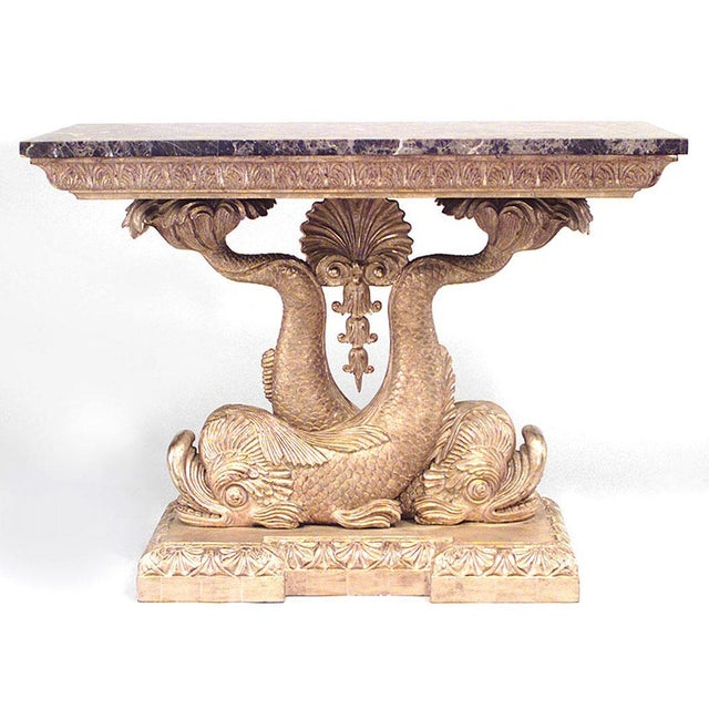 Pair of English Regency style giltwood console tables with brown marble top on entwined dolphins supporting centre shell...