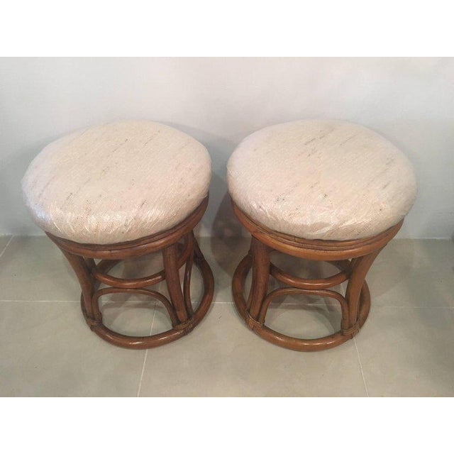 Great pair of vintage rattan stools, benches. These would be perfect under a console table! Newly upholstered (plastic is...