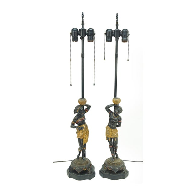 A PAIR OF BLACKAMOOR FIGURES. Painted metal figures depicting a male and female with baskets on their heads. Retrofitted...