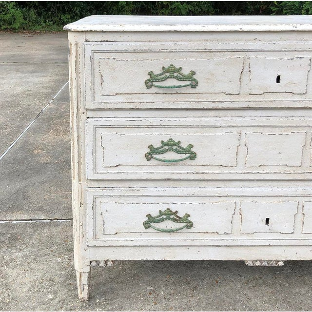 18th Century French Louis XVI Painted Commode features a rustic Country French effect, yet classical embellishment...