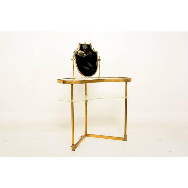 For your consideration a vintage Italian Vanity. Brass frame or structure supports top with glass and glass shelve. The...