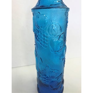 Vintage Blue Glass Wine Bottle With Stopper and Raised Fruit Design Preview