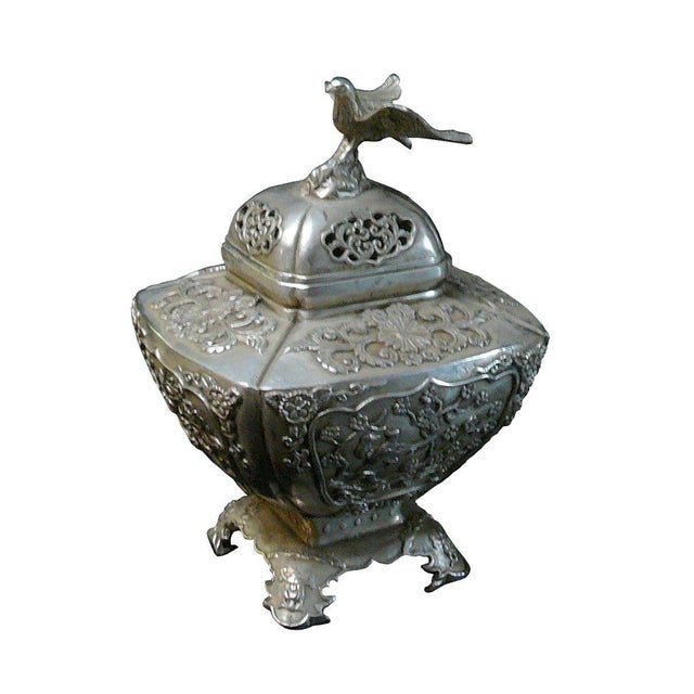 Handmade square vase shape incense burner with eagle top, this unique incense burner is made of metal with silver coating,...