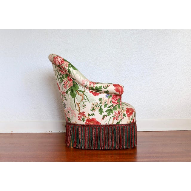 Early 20th Century armchair with a rounded back in floral upholstery and bullion fringe. This sweetheart is small, but...